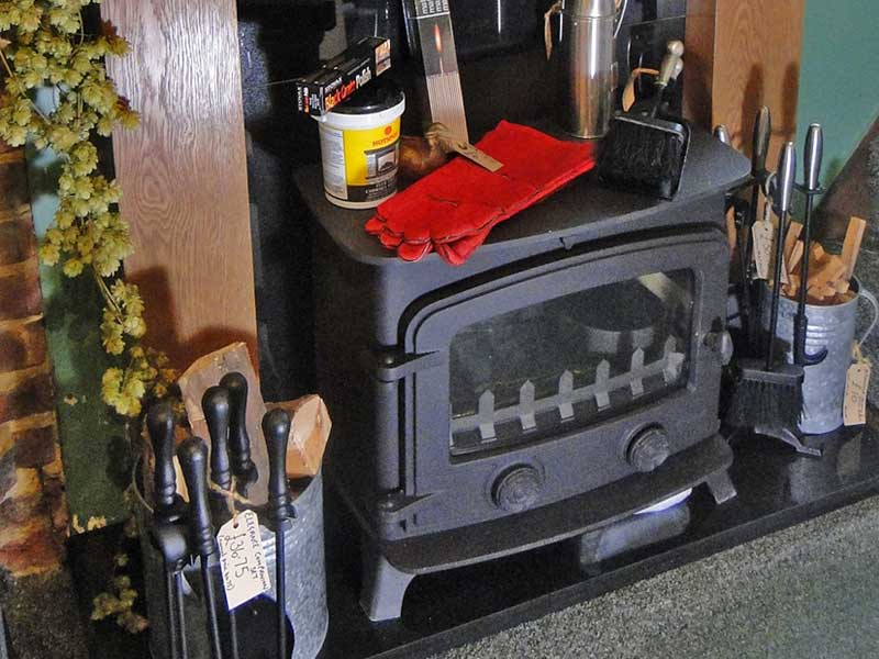 Log burning stove and stove accessories
