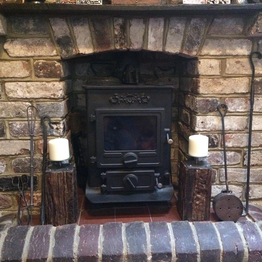 Multi fuel stove in a brick fireplace