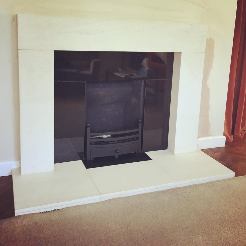 Portuguese limestone fireplace with granite insert